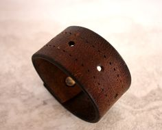 Women's handmade brown leather cuff with cutouts, leather bracelet