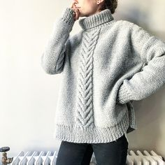 The Staghorn Sweater is a bold, classic design with an oversized silhouette that drapes beautifully from dropped shoulders, enveloping you in coziness. Its singular, centered staghorn cable pops on a reverse stockinette stitch background, making it perfect for layering under your favorite leather jacket or winter coat.