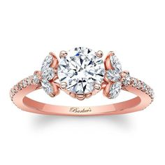 This unique rose gold engagement ring features a prong set round diamond center. The center is flanked on each side by a spray of marquise cut diamonds with round diamond melee adorning the dainty shank.<br /> <br /> Also available in white, yellow gold, 18K and platinum.