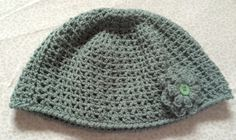 Ladies beanie hat with flower  Size: approximately 22 (56cm) all round  30% wool 70% Acrylic  Machine washable at 40c  Would go lovely with my fingerless gloves https://www.etsy.com/uk/listing/279986096/wool-blend-dk-crochet-fingerless-gloves