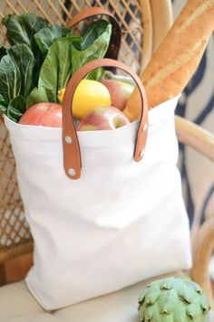 To Market, To Market  This DIY upcycles old belts and turns them into handles. taking an  otherwise boring bag from simple to market ready. Hit the beach or the  park, this bag works great with leather or nylon handles!  Materials Needed  canvas tote   old belt   scissors &