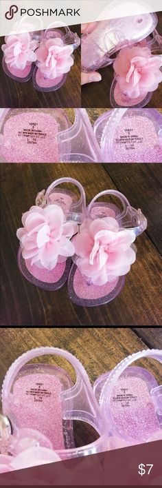Baby girl pink glitter sandal with flower on top These sandals are so cute! We only hot maybe one pair out of them before she outgrew them though! Shoes Sandals & Flip Flops