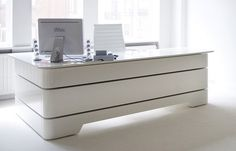 An Art Déco influenced contemporary executive desk by RKNL Furniture studio. Each desk is custom made and is available with numerous option and finishes.