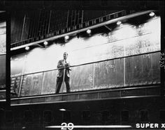 "Unidentified man standing in front of a ""Trade"" board by Stanley Kubrick. Raw Collection by Lineature"