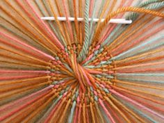 Circular weaving --- so many creative options, using cardboard, yarn, & a yarn needle!