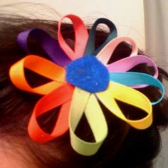 Daisy girl scout hair bows. I made them for the whole troop. We wear them to meetings and on trips. I sell them too!!!