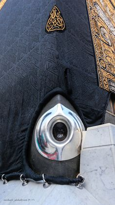 The Black Stone; attached to the bottom of Kabbah (Islamic pilgrimage location). Believed by Muslims to be an outerspace stone capable of soul cleansing and wiping of sins.