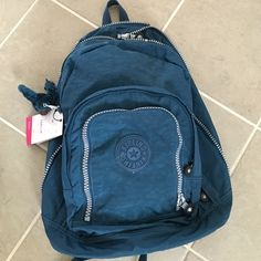Adorable Kipling back pack Brand new roomy and lite.   So so practical and adorable!!.  Pics are representing it's color pretty closely.  Gorgeous deep blue.  Enjoy;) Kipling Bags Backpacks