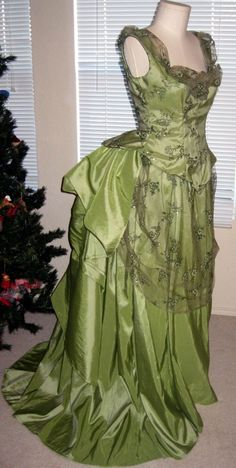 Stunning Moss Green Bustle  ~Wore something very like this for our church's 100 year anniversary (1885, in 1985) - I was 12, and the minister's wife, an amazing woman, made up these period- perfect dresses for each of the girls in the choir. Mine was this colour. I was in heaven.