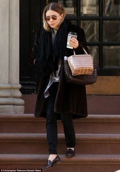 Bundled up: Ashley Olsen sported a long fur coat as she stepped out in New York City's East Village on Tuesday