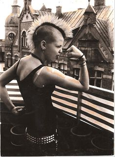 (PM) Female punk showing her guns,  mohawk, rooftops