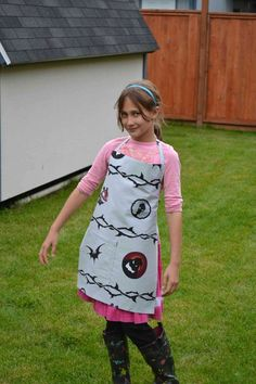 This is an upcycled apron I made from a Nightmare Before Christmas flat sheet. It has bats, the boogie man smiling, thorns, and little creatures that are spooky on it! It has a nice spacious pocket on the front bottom where the bat creature is. It has ribbon straps on each hip, and the