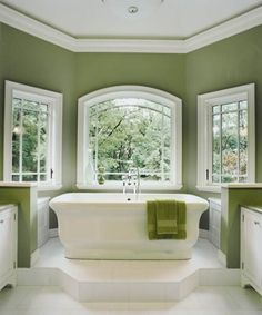 Check out this beautiful bath renovation from This Old House Magazine -- the shower is especially enviable. Kale-like wall paint color? It's Sherwin-Williams Grassland SW 6163
