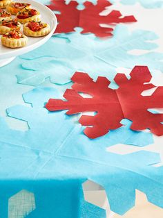 Make a boring table cloth extra special with colorful snowflakes cut from paper napkins!