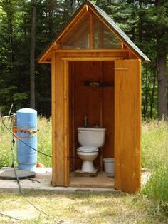 outhouse with flushable toilet