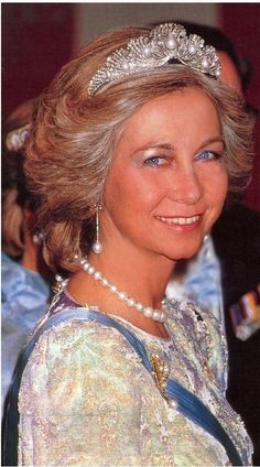 Queen Sofia of Spain wearing the Mellerio Shell Tiara and a pearl earrinfs and necklace
