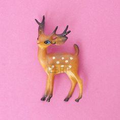 Google Afbeeldingen resultaat voor http://us.123rf.com/400wm/400/400/brookefuller/brookefuller1011/brookefuller101100042/8135252-vintage-herten-vakantie-speelgoed-op-een-levendige-roze-achtergrond.jpg