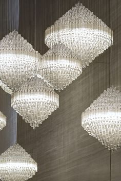 Permanence by Lasvit for The Steigenberger Hotel, Dubai. This bespoke installation blends the traditional with the contemporary in all its aspects – concept, design and manufacturing techniques. The installation consists of five separate and distinctive conically shaped units, carrying their light-source inside. Its diamond shaped design references the vintage feel of functionalist restraint, allowing an installation that enhances the surrounding decor.