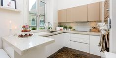 lower white cabinets with white quarts countertop