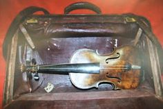 A violin being investigated that may have belonged to Hartley,  or possibly played by him on Titanic.