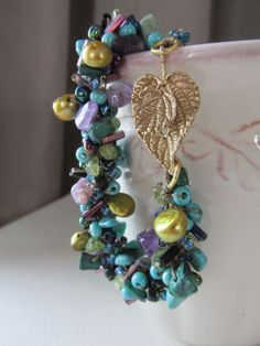 Peacock Tail Feather Crocheted Bracelet von 3pearls auf Etsy, $31.50