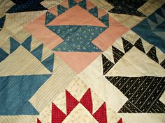 A nice hand pieced, hand stitched, early 1900's quilt top in a basket pattern. Assorted calico colors in blue, maroon, red, pink and black. Some stripes, checks and some dots fabrics. Plus a neat c