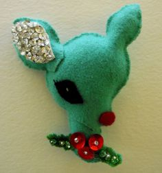 Reindeer Ornament, free pattern! She has posted several more free ornament patterns after this one. Cute and very kitschy :)