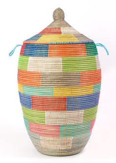 """This one-of-a-kind African basket was specially selected during a trip to Senegal. Measures 33""""H. #baskets #weaving"""
