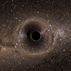 This might be just a simulation of two merging black holes, but it's still insane to look at.