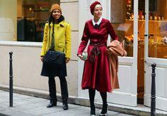 On Chioma: Opening Ceremony jacket, J.W. Anderson x Topshop skirt  On Elisa: Paule Ka coat, Tory Burch shoes