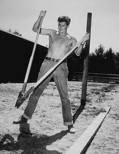 Ronald Reagan digging fence post holes at his ranch in Northridge California