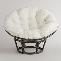 Feel the stress of the day melt away as you sink into our luxurious Ivory Faux Fur Papasan Chair Cushion. This budget-friendly chair cushion is built for durability and comfort with wonderful-to-the-touch faux fur upholstery and plush filling. A World Market bestseller!