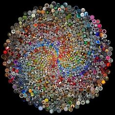 beautiful...made of buttons.  really cool.  josh and i want to make one whole wall in our living room all covered in buttons.  wonder if we should do a circle pattern like this or just random??