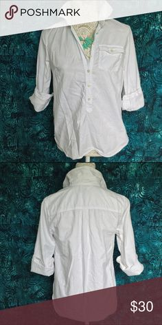"""J. Crew // Factory Oxford Popover - white Throw on this popover for a quick stylish upgrade from J. Crew Factory. Lightly worn but in great condition. Full long sleeves with button cuffs. Buttons 3/4th down the front and a shirttail hemline.   100% cotton  Measurements: Bust 38"""" Waist 38"""" Hip 38"""" Length 21""""  Sleeve length 24"""" J. Crew Tops Button Down Shirts"""