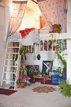 Feeling the vibe of the space. The living space seems like a cozy place to read at the lower chairs and table. The loft is perfectly messy with an interesting array of blankets.