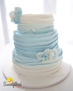 Ruffle cake with a touch of ombre in pale blues www.sunnygirlcakes.blogspot.com