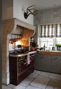 I'd like to see the kitchen with a warmer touch, but treating the stove like a hearth -- smart idea.