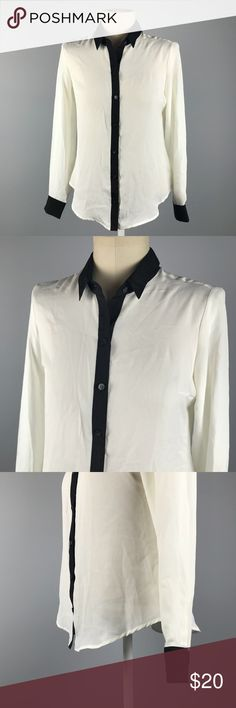 """NY&CO Tailored Button Down Work Shirt Excellent condition New York & Co Black and White Tailored Button Down Shirt. Size Medium. 100% polyester. Tailored back Seams. Tipped in black. Bust 40"""", length 26"""", sleeve length 24.5"""". No trades, offers welcome. New York & Company Tops Button Down Shirts"""