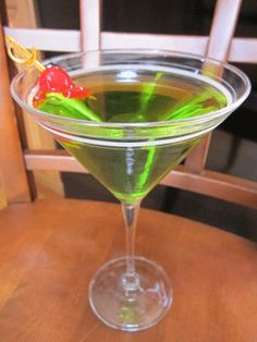 Green Apple Martini: 1 ounce vodka; 2 ounces Apple Pucker liquor; 1 green apple slice; 1 maraschino cherry. Fill a cocktail shaker with ice cubes. Pour in vodka and Apple Pucker. Strain into a chilled martini glass and garnish with apple slice and cherry.        Read more: http://www.theme-party-queen.com/pear-vodka-martini.html#ixzz1qKieVWXP