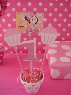 Hostess with the Mostess® - Baby Minnie Mouse first birthday centerpiece