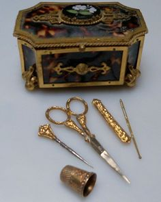 Presenting a very beautiful Victorian Tortoise with Pietra Dura design sewing box. This box opens up to reveal on its lid a wonderful set of matching gold tools. The date of this thimble is December 25,1858 and it is ornate with a rose gold floral design.