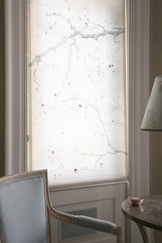 Hand-painted blossom design on plain cream roller blinds, to create the appearance of trees in blossom outside the windows. Trompe l'oeil effect.
