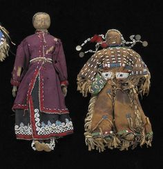 Two Native American beaded dolls