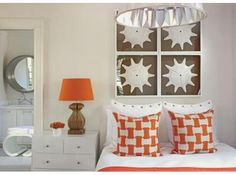 love the pictures great color in the pillows and lampshades of the bedroom.