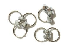 Fidget Toy - Sensory Toy - Anxiety Toy - Calming Toy Set of 3 metal pocket fidgets. Each of the fidget toys are a different combination of rings and hex nuts. Small enough to easily fit in a pocket, add to a keychain, or attach to a bag. Fidget with one during a work meeting; let you child use one for better focus at homework time; or grab one yourself to pass the time in the grocery store line! Simple but highly addictive. 3-ring fidget flips inside out 2-ring fidget flips back and forth…
