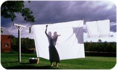 Bed Linens Hung On The Clothesline. you couldnt wait to go to bed to smell the fresh clean air in them