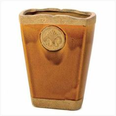 Ceramic Florence Medallion Collectible Home Decor Vase by Furniture Creations. $7.68. Beautifully offset by rough finished medallion and rims.. Intriguing and artistically designed ceramic vase.. Great gift idea for any housewarming.. Caramel color with a smooth and sandy textured finish.. Wonderful centerpiece and décor item for any interior theme.. Buttery caramel glazed vase is elegantly offset by rough finished medallion and rims. A theatrical combination of smooth and s...