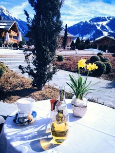 The Alpina Gstaad. Having a drink on the terrace