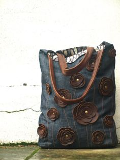 Denim Canvas Tote with Studded Brown Leather Floral Applique. Love it!!