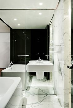Hotel bathroom. Could I mirror the wall opposite the bath to make the room seem wider and more square?